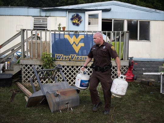 A West Virginia Natural Resources police officer carries
