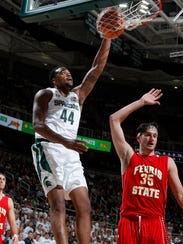 Michigan State's Nick Ward (44) dunks against Ferris