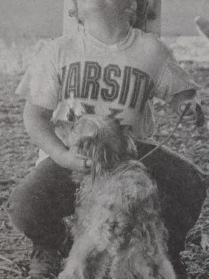 Matthew Underwood reacted to seeing his dog Kasey getting a perfect score in the 4-H Dog Obedience Show at the Redwood County Fair, as seen in this photo that first appeared in the July 10, 1995 Redwood Gazette.
