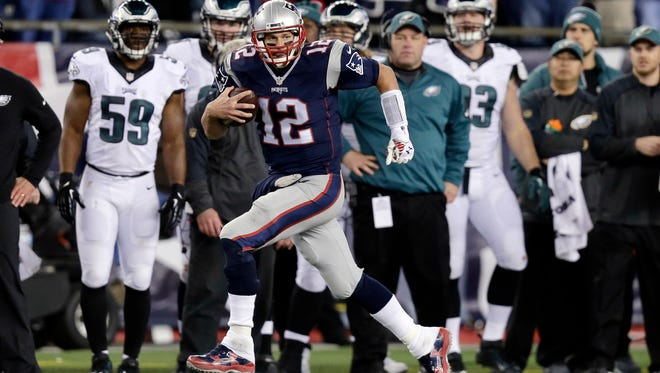 New England Patriots quarterback Tom Brady (12) runs along the sideline after catching a pass from Danny Amendola during the second half against the Philadelphia Eagles on  Dec. 6, 2015.