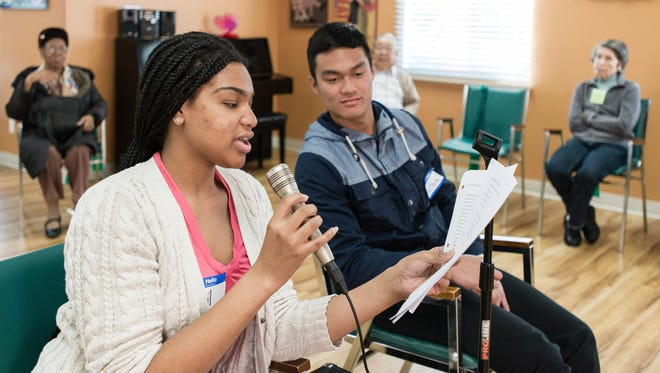 Student volunteer April Pearce led the mind exercises, a quiz game about football, at the WISE & Healthy Aging adult day service center in Santa Monica, Calif., on  Feb. 4, 2016.