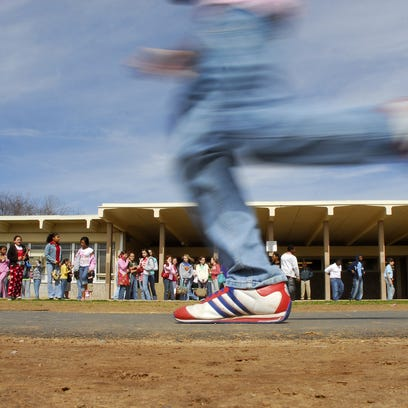 In this Times file photo, students are seen running