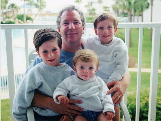 Phil Valentine with his sons, left to right, Carr,