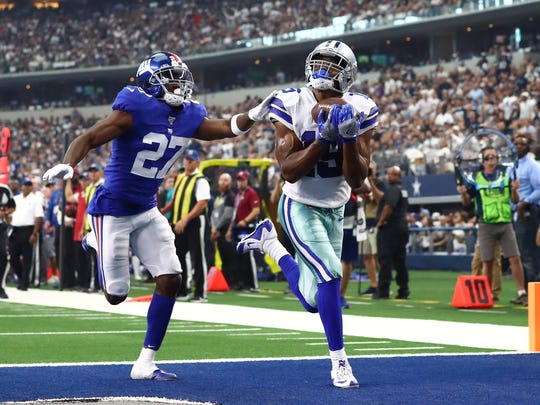Sep 8, 2019; Arlington, TX, USA; Dallas Cowboys receiver Amari Cooper (19) catches a second quarter touchdown pass against New York Giants cornerback DeAndre Baker (27) at AT&T Stadium. Mandatory Credit: Matthew Emmons-USA TODAY Sports