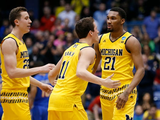 Michigan Wolverines guard Zak Irvin (21) reacts with