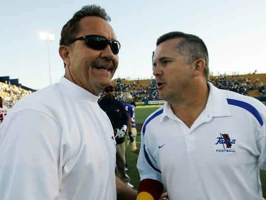 SMU head coach Phil Bennett and Tulsa head coach Todd Graham shake hands following a 2007 college football game that Tulsa won 29-23.