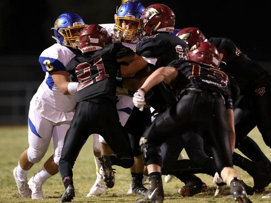 West Valley's Myles Gibbons, from left, and Devin Low converge on Anderson's Parker Phillips during the Eagles' 48-7 win over Anderson on Friday in Cottonwood.