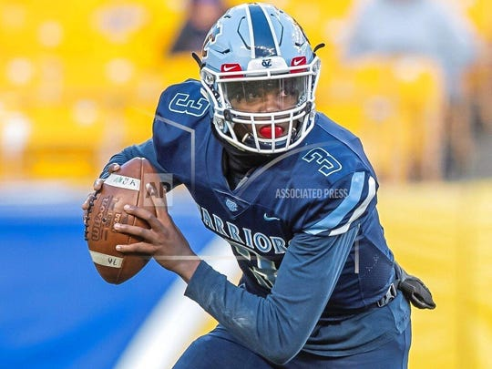 "In this Nov. 16, 2019 photo, Central Valley's Ameer Dudley looks to pass during the WPIAL Class 3A championship at Heinz Field in Pittsburgh. Ameer, 17, is a junior at Central Valley High School and one of the most sought-after quarterback recruits in the area. He treats every game of ""Madden NFL"" or ""NBA 2K"" just as seriously as he does playing in a WPIAL championship game at Heinz Field — as long as he's competing against friends. (Steph Chambers/Pittsburgh Post-Gazette via AP)"