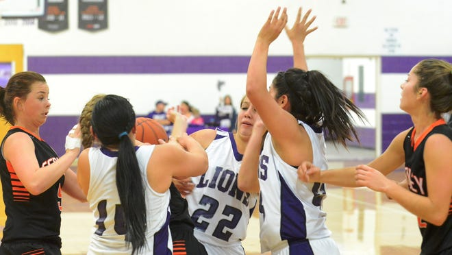Fernley and Yerington players battle for a loose ball during the Dec. 2 girls basketball game played in Yerington.