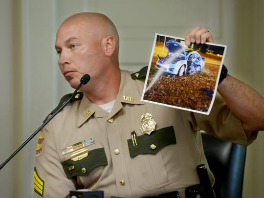 Tennessee State Trooper Justin Boyd holds up a photo of the car of Jay and Julie Hogan after it was hit, killing the couple. Boyd, who is a member of the Critical Incident Response team, testified during a probable cause hearing for Jordan Bailey, Wednesday in Juvenile Court.