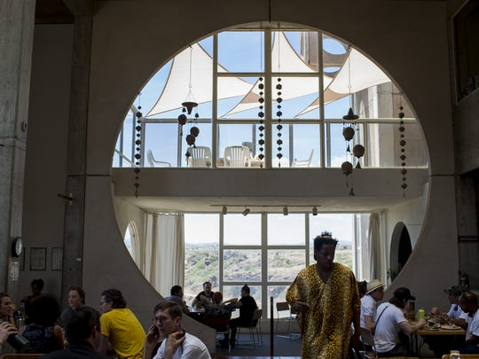 Artists and employees eat inside the Artists' Cade at the FORM Arcosanti festival on May 12, 2017.
