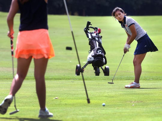 Mary Grace Mancuso (Blackman) putts the ball during the 2016 District 7 AAA golf tournament at Indian Hills.