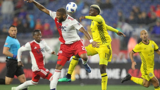 New England Revolution defender Andrew Farrell (2) and Columbus Crew forward Gyasi Zardes (11) battle or possession of the ball during the first half of an MLS soccer game at Gillette Stadium in Foxborough, Mass, Saturday, May 19, 2018. (AP Photo/Stew Milne)