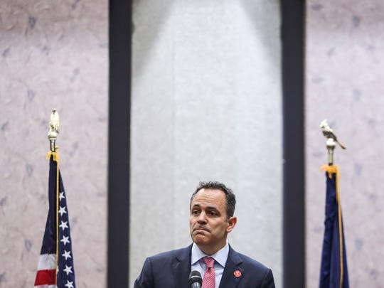 Gov. Matt Bevin speaks during a partnership announcement of the nonprofit group Foundation for a Healthy Kentucky with the state called Kentucky HEALTH. The Bevin administration has projected about 95,000 people will lose Medicaid coverage over the five-year plan. May 30, 2018.