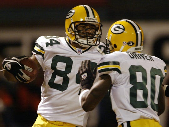 Javon Walker celebrate his touchdown catch with teammate Donald Driver during the first quarter against the Oakland Raiders on Dec. 22, 2003. The Packers won, 41-7.