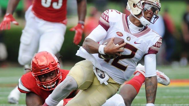 Louisville's Jonathan Greenard (left) sacks Florida State quarterback Deondre Francois (12) on Saturday at Papa John's Cardinal Stadium. UofL won 63-20. (Photo by David Lee Hartlage, Special to The Courier-Journal) Sept.17, 2016