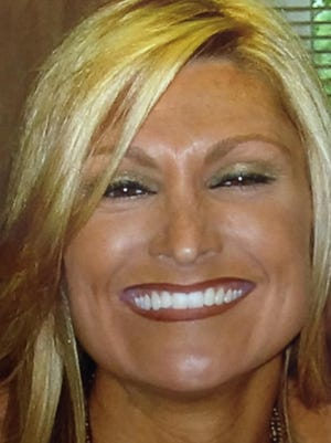 Carol Bowne was fatally stabbed while awaiting the state's permission to buy a gun for protection from an ex-boyfriend.