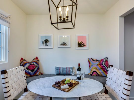 La Serena Villas added pops of color in the dining room with Fond Industries' Shimmer Kilim Pillows.