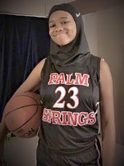 Camrin Hampton, a freshman at Palm Springs High School, smiles seconds after receiving and putting on her Nike Pro Hijab.