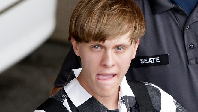 In this June 18, 2015, file photo, Charleston, S.C., shooting suspect Dylann Storm Roof is escorted from the Cleveland County Courthouse in Shelby, N.C.