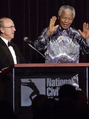 Former president of South Africa Nelson Mandela receives the National Civil Rights Museum's Freedom Award in 2000. AutoZone founder J.R. 'Pitt' Hyde is at left. Hyde will receive the Freedom Award this year.