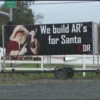 Billboard for Butte County, CA gun range shows Santa