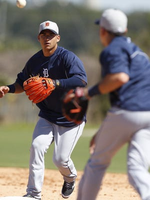 Detroit Tigers shortstop Jose Iglesias takes a throw at second base while taking infield practice at spring training in Lakeland, Fla., on Feb. 16, 2014.
