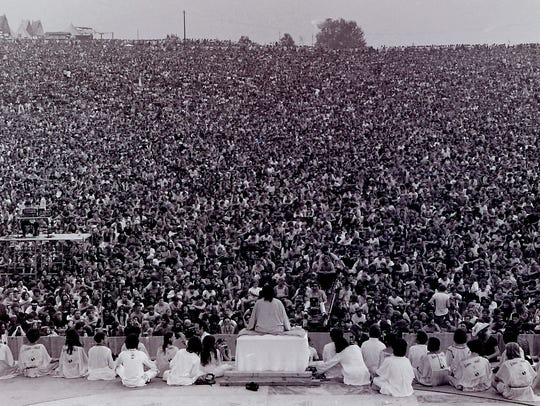 Swami Satchidananda gave the opening Woodstock speech
