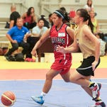 From left, K. Unpingco of the Crusaders tries to steal the ball from Rena of the Rebels during the Guam Youth Basketball Association Drug-Free Youth Basketball League game at Guam sports complex gym on July 27. Crusaders won against the Rebels with a score of 47-5.