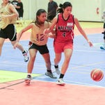 From left, K. Unpingco of the Crusaders tries to steal the ball from Rena of the Rebels during the Guam Youth Basketball Association Drug-Free Youth Basketball League game at Guam sports complex gym on July 27. Crusaders won against the Rebels with a score of 47-5. Rudy Capistrano/For PDN
