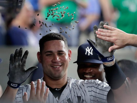 New York Yankees' Gary Sanchez is showered with sunflower seeds after hitting a solo home run against the Cleveland Indians during the fifth inning of a baseball game Friday, May 4, 2018, in New York.