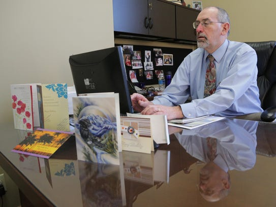 Reflected in his desk and surrounded by birthday cards