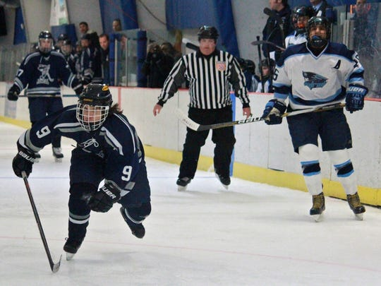 Anthony Gallichio (9) of Howell races after a loose puck.