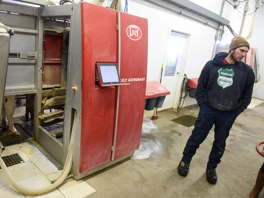 Isaak Hinnenkamp talks about the operation of robotic milking equipment Tuesday, March 6, during a tour of his farm near Melrose.