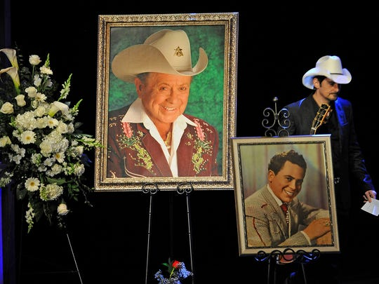 Brad Paisley enters the stage to honor his friend Little Jimmy Dickens during a celebration of life service at the Opry House. Thursday Jan. 8, 2015, in Nashville, TN