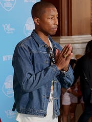 """Pharrell Williams arrives at the Special Screening of """"True and the Rainbow Kingdom"""" at The Grove on Thursday, Aug. 10, 2017, in Los Angeles."""