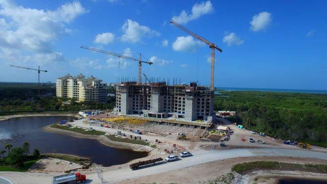 Cranes are now part of the landscape along Vanderbilt Drive as Kalea Bay rises next to a new tower at Aqua.
