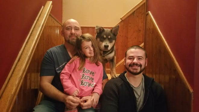 Bob Meyer, left, with daughter Emily and son Arcangelo, with Homer, the dog they adopted in September from Bonnie's Animal Rescue Kingdom in Paramus. Homer was one of the puppies participating in Animal Planet's Puppy Bowl XIII, to air on Super Bowl Sunday.