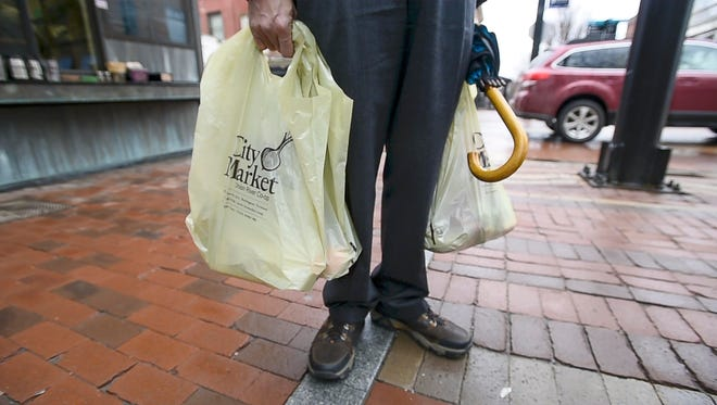The Legislature is considering a pair of proposals that would ban single-use, non-recyclable and non-compostable bags, or charge a dime for their use, in Burlington on Wednesday, April 5, 2017.