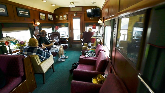 Passengers can relax in the cars' staterooms as they ride the rails.
