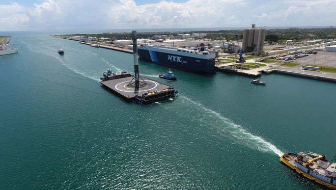 A SpaceX rocket returns to Port Canaveral after being recovered at sea.