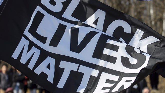 A Black Lives Matter Flag was raised outside Burlington High School on Monday, February 19, 2018.