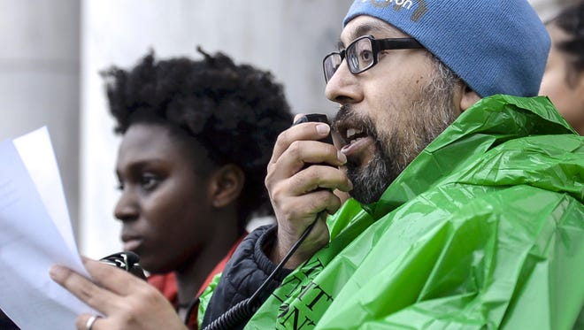John Mejia, a staff member at the University of Vermont, speaks to a rally organized by NoNames for Justice at UVM in Burlington on Tuesday, February 21, 2018.  Meija is hunger striking until their demands concerning issues of racial justice are met.