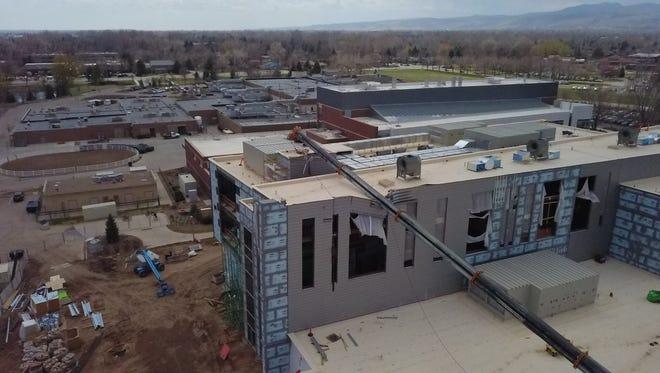 A crane tipped overat Colorado State University's C. Wayne McIllwraith Translational Medicine Institute research facilityonMonday.