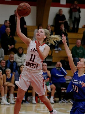 Lourdes Academy's Alexis Rolph drives to the basket against St. Mary's Springs' Sydney Lavey on Dec. 5.