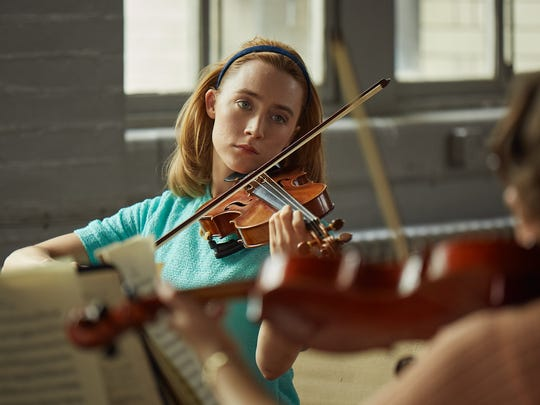 """In """"On Chesil Beach,"""" Florence (Saoirse Ronan) dreams of a career with her classical quartet."""