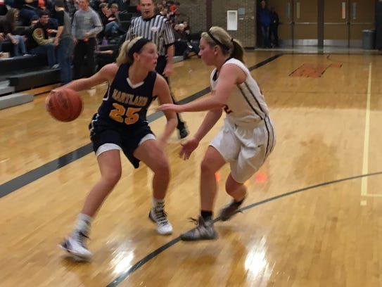 Hartland's Lexey Tobel dribbles the ball while guarded