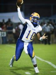 A.I. du Pont quarterback Chad Jones II passes during