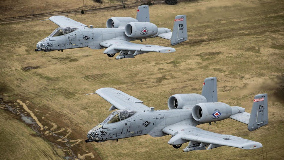 Two A-10s conduct a training mission over Razorback