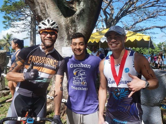 From left, Derek Horton, Alejandro Atoigue and Derek Mandell won the 2015 Guam National Triathlon team championship on Sunday, July 19 at Merizo pier.